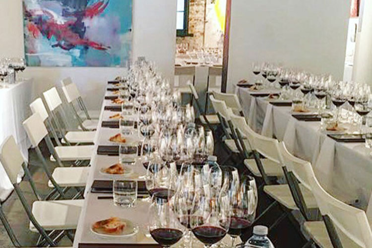 Wine glasses set up on tables for event at Arta Gallery venue