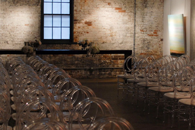 Chairs setup for wedding ceremony at Arta Gallery venue space