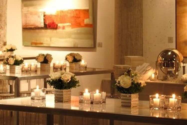 Arta Gallery tables with candles and flowers for an event in Toronto