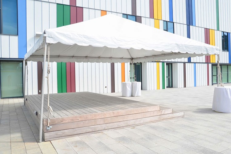 Tent setup in front of rainbow exterior wall at Artscape Daniels Spectrum venue rental space