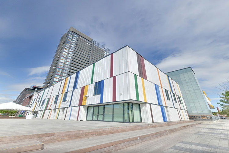 Colourful rainbow facade on exterior building at Artscape Daniels Spectrum