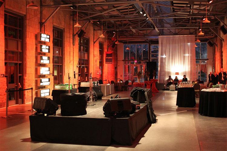 Event at night inside Artscape Wychwood Barns