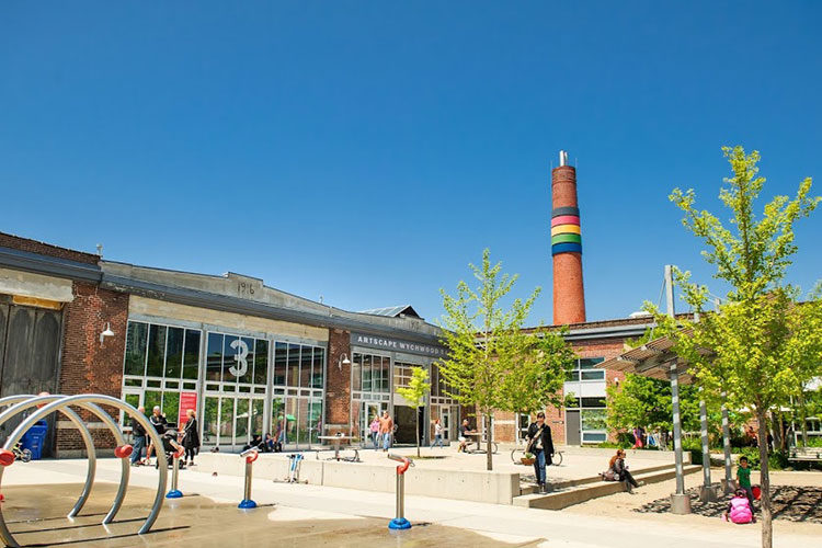 Exterior view of Artscape Wychwood Barns in Toronto on a sunny summer day