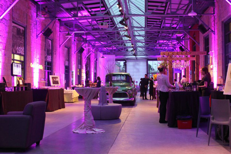 Artscape Wychwood Barns event with purple lighting at venue space in Toronto