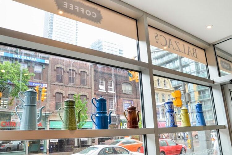 Window displays inside Balzacs Cafe venue space in Toronto