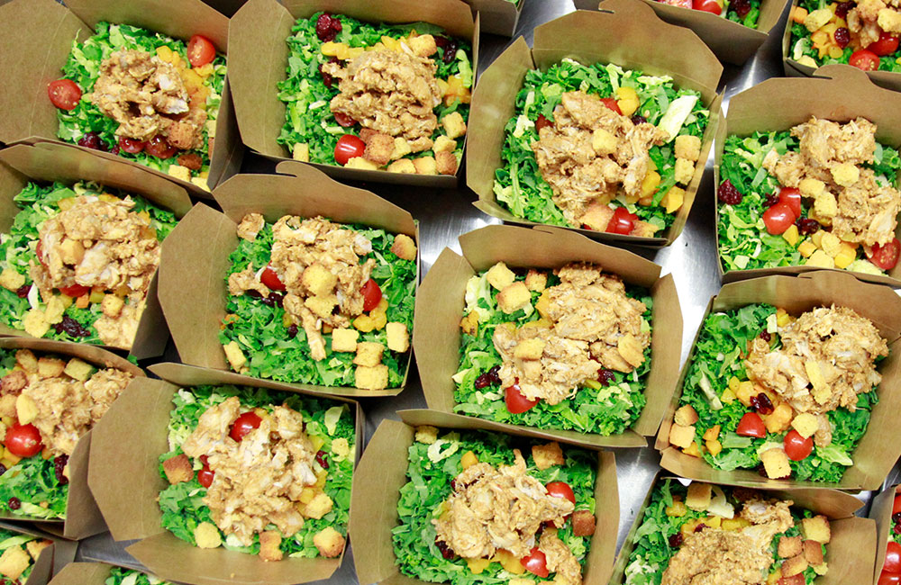 Birds eye view of boxed lunches for corporate catering