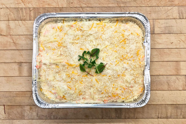 Vegetable lasagna large portion in foil pan, ready for delivery