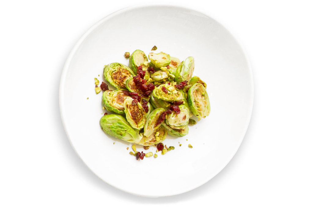 Brussel sprouts with dried cranberries in a white bowl
