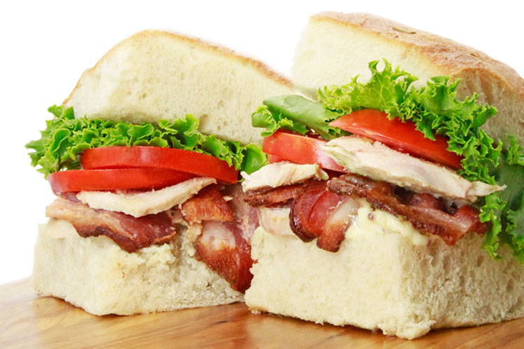Encore club sandwich with bbq chicken, bacon, lettuce, and tomato from catering buffet menu