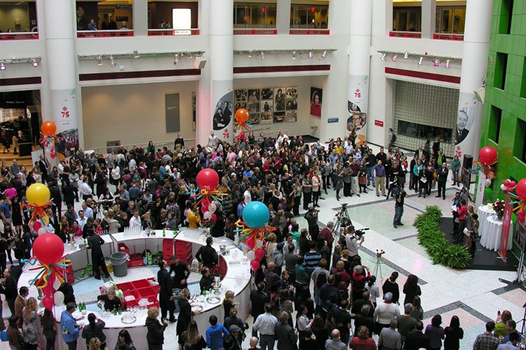 Lots of people listening to a speaker giving a presentation in CBC Atrium venue Toronto