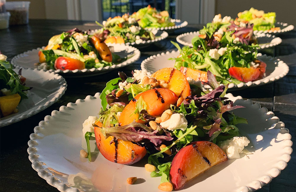 Grilled peach salad starter course for COVID wedding 2021