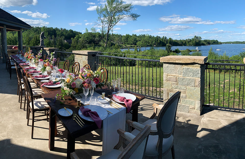 Outside table for guests at COVID friendly wedding at private cottage residence