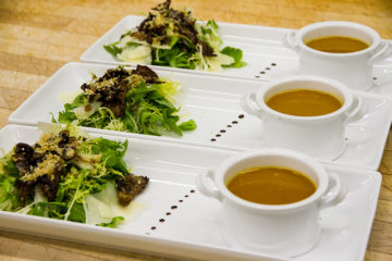 Soup and salad on rectangular white display platter