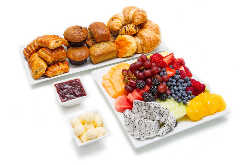Corporate catering breakfast with muffins, danishes, scones and a beautiful fruit platter