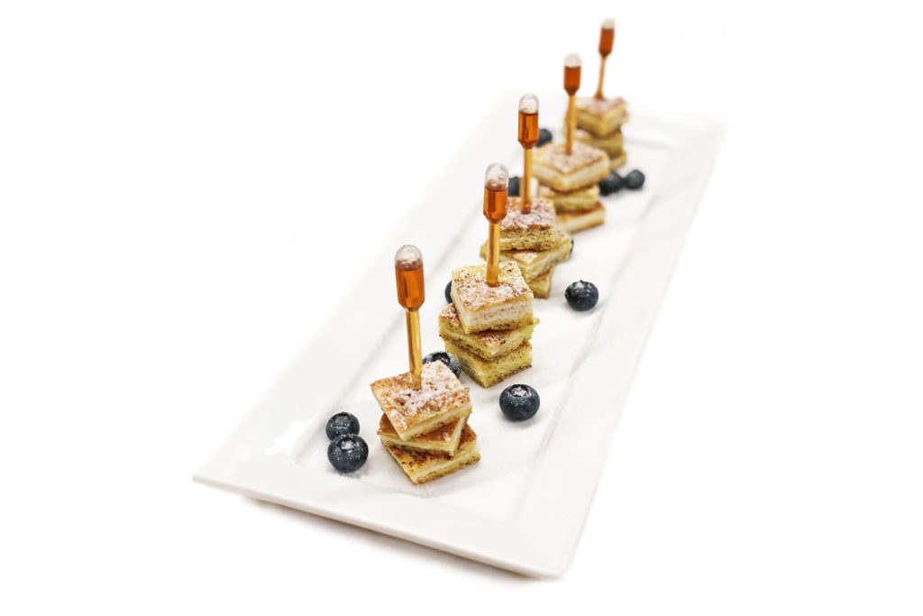 French toast stacks with maple syrup and blueberries for a catered event