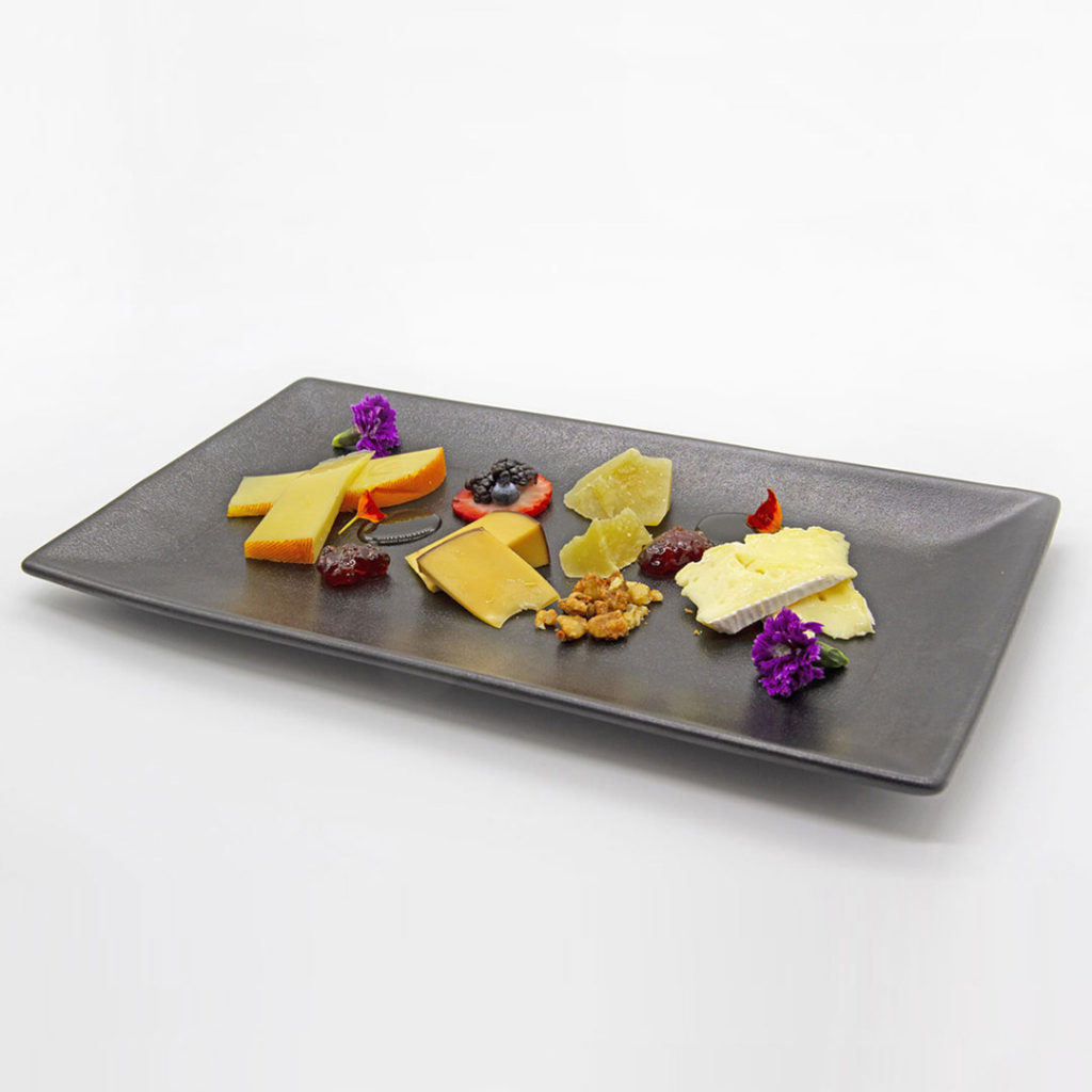 Artisanal Canadian cheeses on fancy black display plate