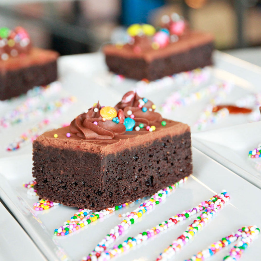 Brownie dessert with colourful sprinkles for children dessert at a wedding