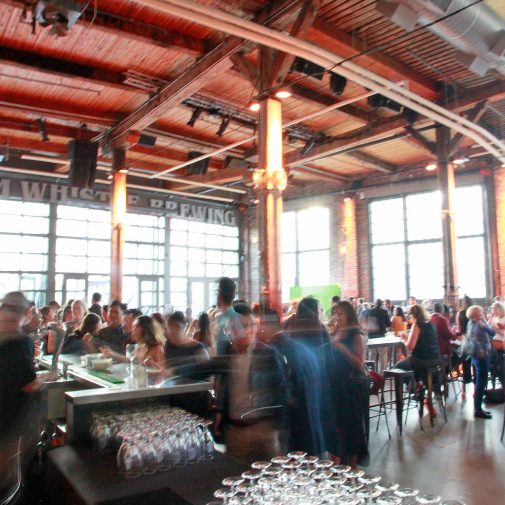 Event at Steam Whistle Brewery in Toronto with people walking past the camera