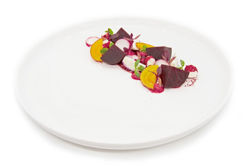 Heirloom beet salad fancy plating on a white circle plate