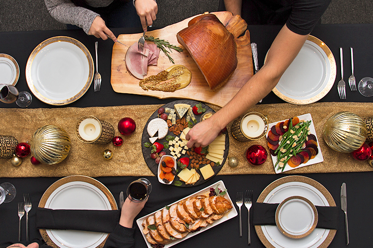 Family style dinner for the holidays with ham, chicken, and side dishes