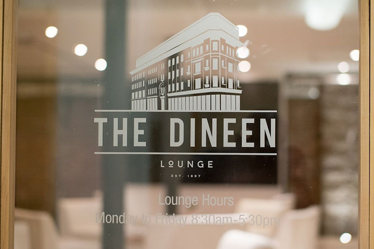 The Dineen Lounge by IQ Venues sticker on front door window