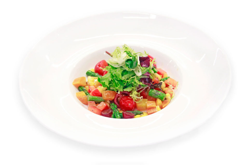 Mixed salad with tomatoes, asparagus, carrots and other vegetables