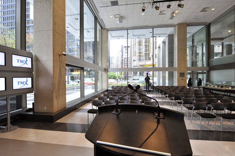 Podium and chairs set up inside the TMX Broadcast Centre for a speaker