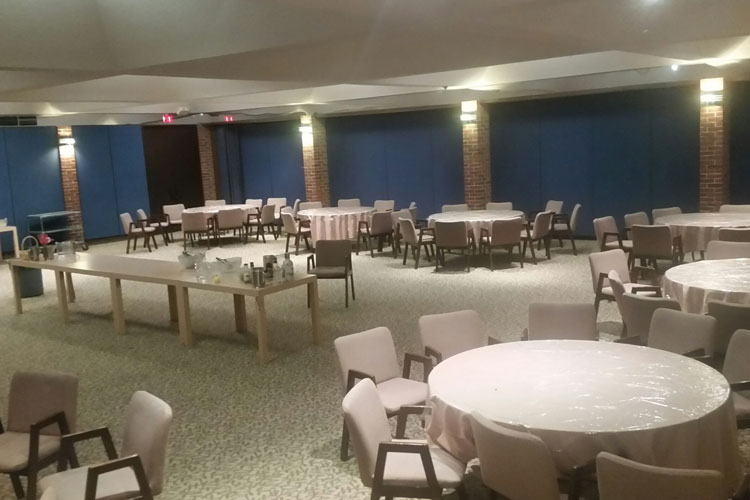 Temple Emanu-El table and chairs set up for an event before the guests arrive