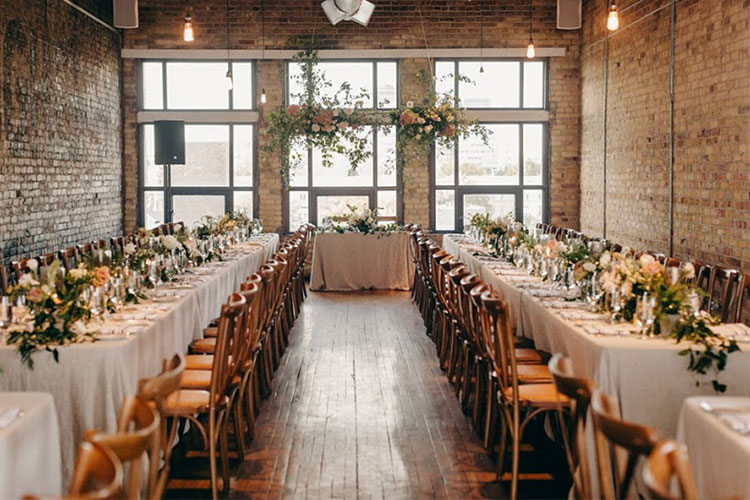 Elegant wedding tables and decor at The Burroughes with brick wall interior