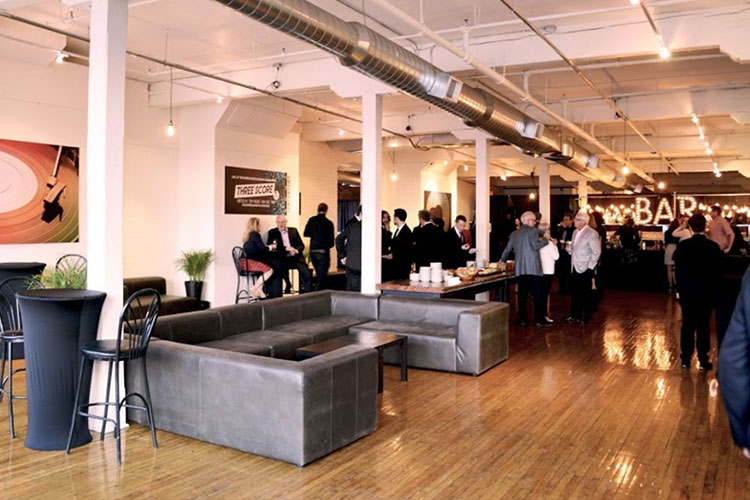 Inside The Burroughes venue space with people talking during event