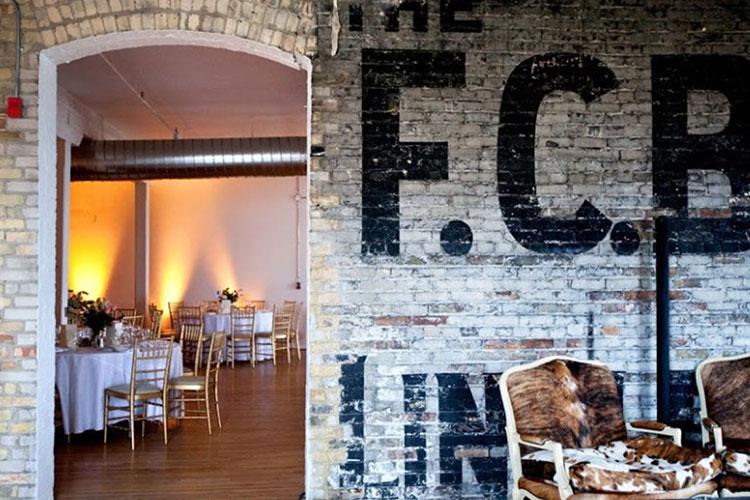 Brick wall interior of a room at The Burroughes event venue