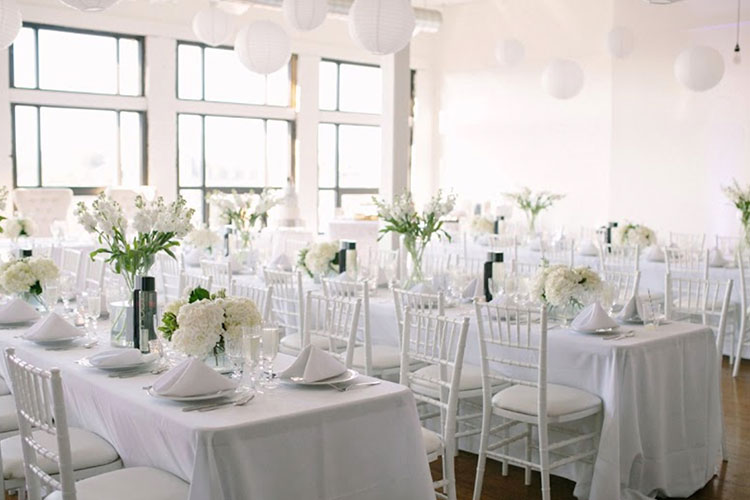 White table and chairs with flowers decor for wedding at The Burroughes venue