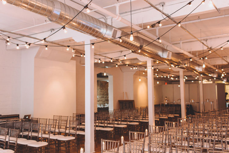 Chairs set up for wedding ceremony at The Burroughes venue space