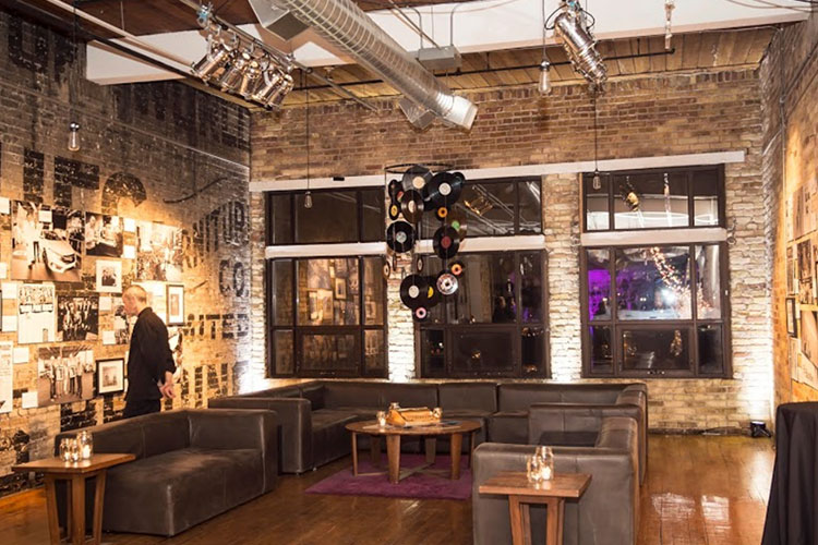 Trendy room with leather sofas at The Burroughes venue rental space