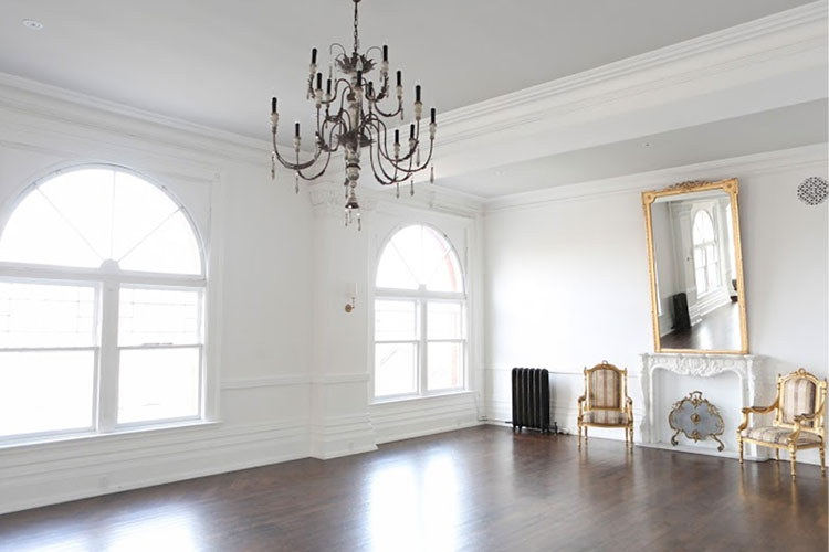 Interior room with white walls and chandelier at The Great Hall venue