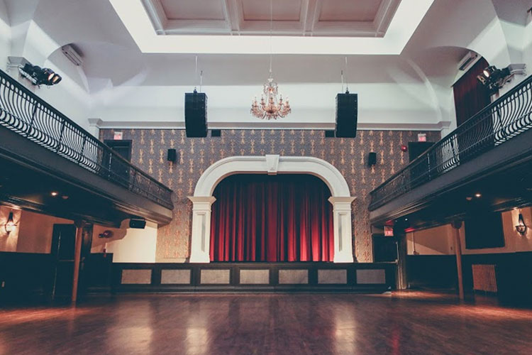 View of stage and curtain in the main room at The Great Hall event venue space