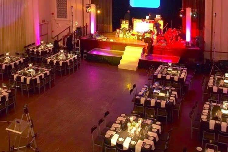 View from high up of square table with chairs for an event at The MET event venue