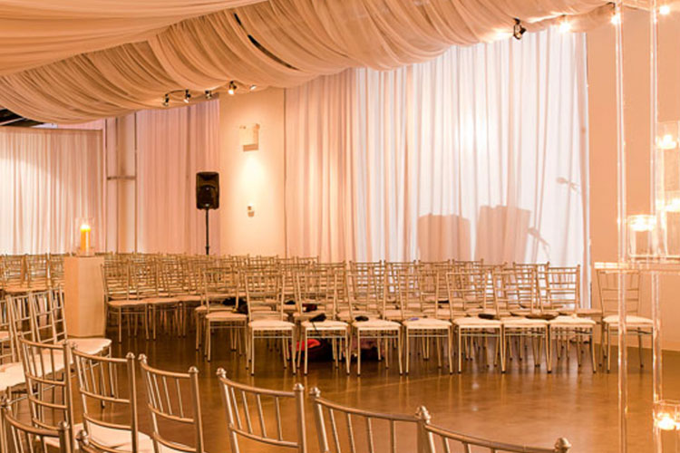 Chairs set up for wedding ceremony at The Warehouse venue