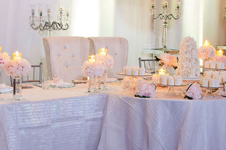 Pretty flowers and table decor for a wedding at The Warehouse event venue