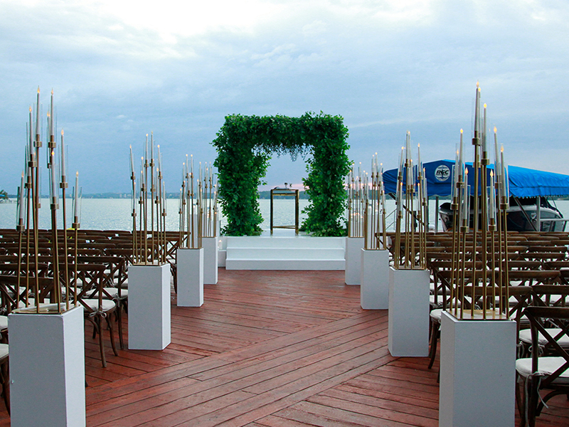 Beautiful wedding ceremony set up on a dock by the water on a private cottage