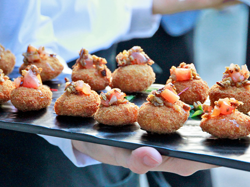 Wedding catering passed appetizer fried eggplant coins